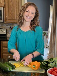 Katie chopping vegetables